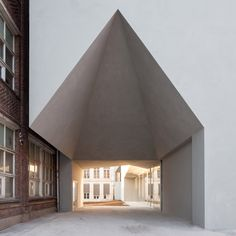 Aires Mateushas completed a new architecture facility at a university in westernBelgium, featuring a huge gabled opening and a double helical staircase.