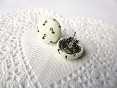 I love the idea of using fabric buttons to decorate mundane things. This tutorial is for making fabric button earrings, but you could ma...