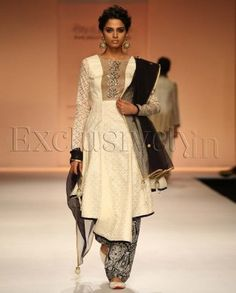 #Exclusivelyin, #IndianEthnicWear, #IndianWear, #Fashion, Najia Cream Layered Hem Kurta With Midnight Blue Pakistani Pyjamas
