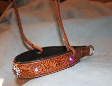 Western style. Bling. Comfortable for the horse. This tie-down noseband delivers in all categories. It is made from an embossed belt, has antiquing to bring out the design and is accented with Swarovski crystals and a Swarovski crusted concho. Does a cowgirl need much else? Oh yea, it has a padded lining. Nosebands   COWGIRL INK
