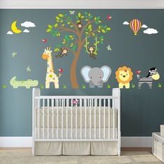 Enchanted Interiors Jungle Wall Sticker Decals Premium Self Adhesive Fabric Nursery Wall Art  Approx Size: 50 high x 100 Wide Can be positioned from the skirting board up or above nursery room furniture.  Captivate your babys imagination with our friendly jungle animals nursery