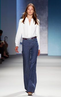 Crisp, tailored white shirt, high waisted flares, belted, platforms: go most anywhere