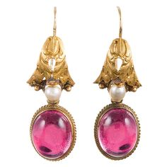 Victorian Foiled Crystal Pearl Gold Drop Earrings. Feminine Victorian earrings, offering a soft combination of golden leaves, sweet pearls and cabochon rock crystal, foiled in pink and framed in braided gold. Made of 18k yellow gold and measuring 1.25 inches long. c 1870-1879