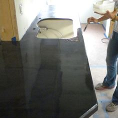 Easy DIY Concrete Counters: The Missing Link. This method seems more professional than the others I have seen.  I could use it in the bathroom as I need to replace the countertops there.
