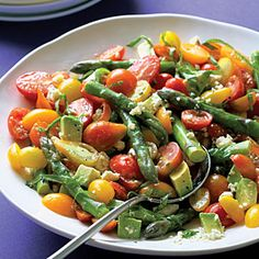 Cherry Tomato and Asparagus Salad; served on bed of fresh spinach, avocado, balsamic vinaigrette