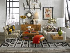 This loft's white washed floors and brick are a blank canvas to have fun with color and pattern