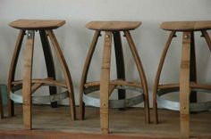 Stools made from parts of old wine barrels. love for a rustic kitchen bar.
