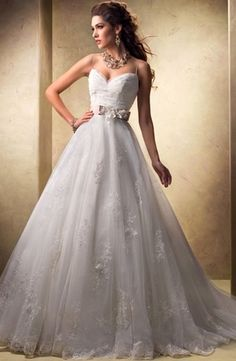 Bridal Gowns: Maggie Sottero A-Line Wedding Dress with Sweetheart Neckline and Natural Waist Waistline. love the top