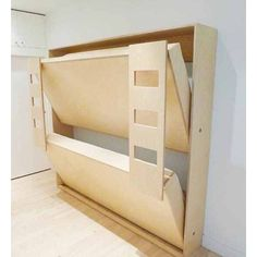 With multiple kids I might like to try the Murphy bed as bunk beds. During the day it allows for more play room. #tinyhouse #tinyhousekids #murphybed by tinyvegantraveler