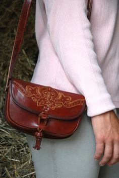 """LILO """"Macarena"""" cross body leather bag has an intricate Spanish Andalusian design and tassel accent."""