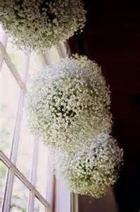baby's breath balls. hang over bar? hang on sheppard hooks for aisles?