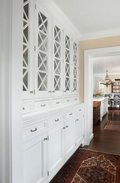 Like how this butler's pantry is a pass-through between the kitchen & dining room. Pretty cabinets too