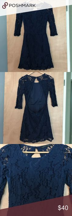 Flirty open back lace dress  Signature 8 Super cute backless lace dress. Pretty deep navy color. The front is lined so you don't need a sticky bra, the sleeves and back are unlined. Surprisingly flattering! Sexy yet classy, great wedding guest dress! Worn once, in perfect condition. Accepting reasonable offers! Anthropologie Dresses Mini