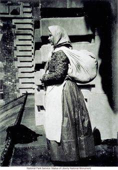 European immigrant at Ellis Island (Photograph by Augustus Sherman)