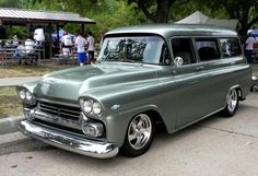 58 or 59, nice looking Chevy Suburban.