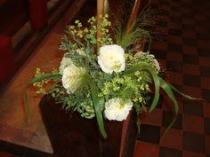 St Mary's Church, Barlavington, pew ends decorated with trailing foliages and scented roses.  Country wedding of Honeysuckle Weeks.