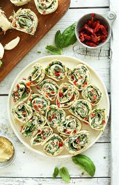Amazing, flavorful Sun-dried Tomato and Basil Pinwheels that come together in 15 minutes with 8 ingredients. The perfect crowd-pleasing, summer appetizer.