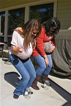 "Baby shower game: ""Tinkle in the potty"" - put a ballon under your shirt and quarter between your knees and try to drop the quarter into a jar......loads do laughs!"