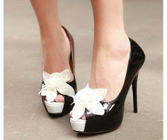 Black heels with white flowers.