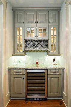 Wet bar...love it but it would need a kegerator or mini fridge instead of a wine chiller to ever make it into our house