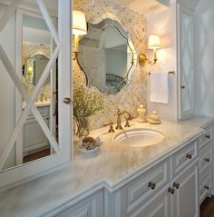 "Mix and Chic: gorgeous bathroom remodel with tile backsplash, vintage mirror, white cabinets and countertops with built-in glass back and ""X-ed"" wood overlay side vanities."