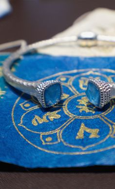 Our silver hammered cuff bracelet was inspired by the deep blues found in monastery paintings on the tibetan plateau. The stones are a blend of turquoise and rock crystal that give this bracelet a one of a kind look.