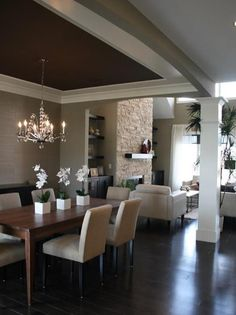 Open concept rooms are so hard: 2-3 shades darker than revere pewter for dining room, accent ceiling with super thick trim