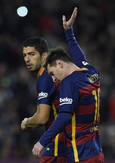 Barcelona's Argentinian forward Lionel Messi (R) celebrates with Barcelona's Uruguayan forward Luis Suarez after scoring during the Spanish league football match FC Barcelona vs Athletic Club Bilbao at the Camp Nou stadium in Barcelona on January 17, 2016.