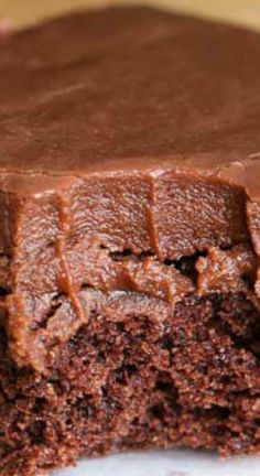 ONE Minute Easy Chocolate Frosting Recipe ~ It is likely the quickest frosting you've ever made... It comes together so fast and sets like a dream making this a go-to quick frosting recipe -  It's perfect for topping cakes, brownies and more!