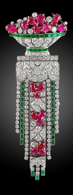 An Art Deco platinum, diamond, emerald and carved ruby basket brooch, French, 1920s. #ArtDeco