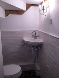 Small under stairs toilet newly built with victorian style in mind