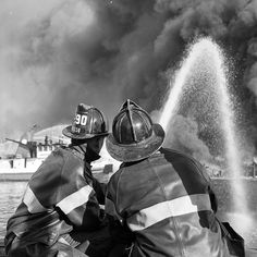 FDNY firefighters battle an 8-alarm fire on Basset Ave in Mill Basin, Brooklyn, on May 10,1962.