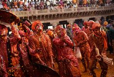 Holi festival: Worshippers from Barsana are sprayed with coloured water by men from Nandgaon / The Guardian