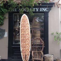 Sibella Court's giraffe print surfboard by McTavish Surfboards. Via sibellacourt instagram