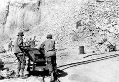Battalion operating a rock quarry near Beau Costil, France, 8 August 1944.