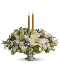 Celebrate the season with this majestic centerpiece of sparkling silver and glamorous gold. Bright white lilies and winter greens arranged in a shimmering mercury glass bowl will cast a lovely light on any holiday table. TF Gold & Silver Bouquet from www.stems4flowers.com