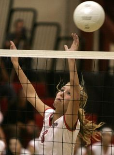 Lake Elsinore High's Michelle Waber, leaps to the net as she guards from a Hemet volley.