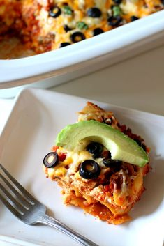 Slow Cooker Taco Lasagna--A lasagna made in your slow cooker with all the fun Mexican flavors found in tacos.