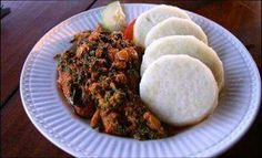 Yam and palava sauce. ( made of spinach, eggs, tomatoes, fish or meat, palm oil)