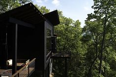 A Rustic-Modern Cabin Inspired by Japanese Bungalows and Shou Sugi Ban - Photo 8 of 12 - One of the pitched roofs shelters a side deck, which has a SwingLab bench.