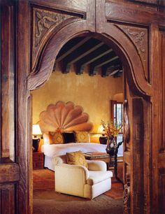"""A suite at the Hacienda de los Santos in Mexico. The shell carved into the wall (!!!) is """"typical of Spanish-Colonial interiors""""."""