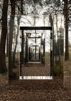 The Stockholm-based Note Design Studio has completed an outdoor art installation of varying-sized stainless-steel structures set on a wooded hillside, titled 'Waiting Windows'; a meditation. Note Design Studio, Notes Design, Portal, Art Public, Instalation Art, Pinhole Camera, Design Jardin, Mirror Art, Foto Pose