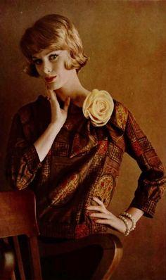 Model in charming print dress by Pierre Cardin, photo by de Vassal, 1961