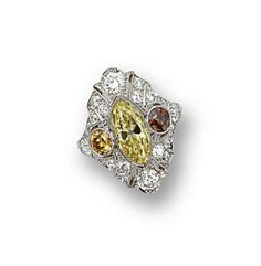 FANCY INTENSE YELLOW DIAMOND RING, CIRCA 1920.  Centering a marquise-shaped diamond of fancy intense yellow color weighing 2.12 carats, within a pierced navette-shaped frame, quartered by 4 old European-cut diamonds, two of orange and brown hues, and with numerous smaller old European-cut and single-cut diamonds weighing a total of approximately 2.25 carats, mounted in platinum, size 7¼.