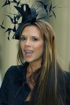 Rocking the long poker straight hair complete with fascinator. Fancy Hats 22b09124b05