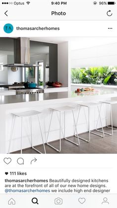 L shape kitchen with island bench. Like island top and colour with sink on side counter