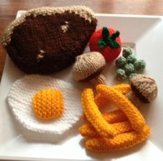 My hand knitted steak dinner with chips, mushrooms, a whole tomato, peas and a fried egg. I had to make the pattern for the piece of steak and was very pleased at how edible it looked