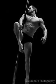 Men on the pole. Their strength is amazing and shows.