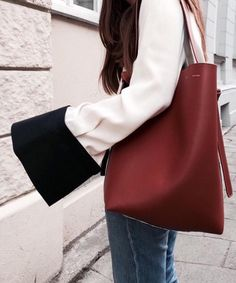 I'm in love with the big ass sleeve cuffs and the leather bag.