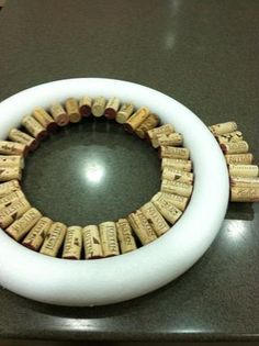 Then start the outer ring. When placing the corks be sure to place them so the ring lays flat on the surface. Wine Cork Wreath, Wine Cork Art, Wine Craft, Wine Cork Crafts, Wine Cork Projects, Craft Projects, Craft Ideas, Champagne Corks, Champagne Cork Crafts